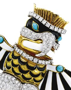 18 Karat Gold, Platinum, Enamel, Turquoise and Diamond Brooch, Donald Claflin for Tiffany & Co. Designed as a Thunderbird with a feathered crown and wings stretched, the wings highlighted with stripes applied in black and white enamel, the torso with black and gold enamel in feather-like patterns, and the mask additionally applied with black and white enamel, set with round diamonds weighing approximately 9.15 carats, accented International Jewelry, Blue Books, Diamond Brooch, White Enamel, Round Diamonds, Antique Jewelry, Gold Platinum, Jewels, Brooches