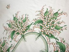 vintage tablecloth, lily of the valley, large rectangular, 10 napkins. $34.00, via Etsy.