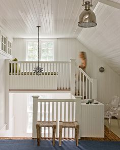 An original third-floor staircase leads to a new built-in seating area opposite the one window in the house that offers a water view. See the transformation of this vintage cottage Home Trends, House, Cottage Style, Home, Old House, Decorative Window Treatments, Attic Design, Built In Seating, Vintage Cottage