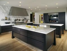 black kitchen island with white marble top