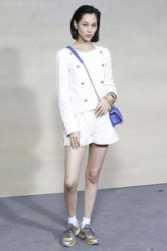 spring 2015 front row, Kiko Mizuhara wearing Chanel basket from fall 2014 (grocery), shorts and jacket as well as a blue Boy bag