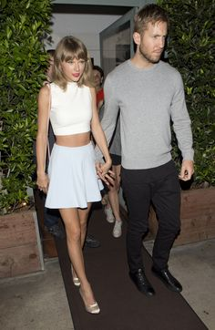 taylor swift is the ultimate crop top and mini skirt expert. she looks cute not trashy