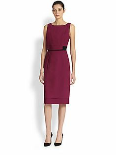 """Carolina Herrera Tiered Sheath Dress  An essential afternoon-and-evening design for the modern sophisticate, tailored from fine virgin wool with tiers of feather-weight crepe that lend subtle, inviting movement.  Boatneck Sleeveless Side zip closure Contrast waistband Side slit Silk lining About 27"""" from natural waist Virgin wool"""