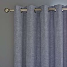 Featuring A Plain Textured Design In Printed Chambray Blue These Eyelet Curtains Are Crafted From