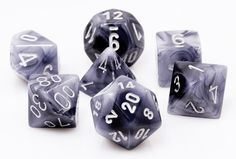 Phantom Dice (Black) are the perfect choice for your favorite RPG adventures. This seven-piece dice set has all your favorites: d4, d6, d8, d10, d%, d12, and d20. Bold and beautiful, Phantom dice are