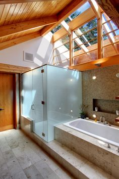bathroom: natural light, stone, wood and glass
