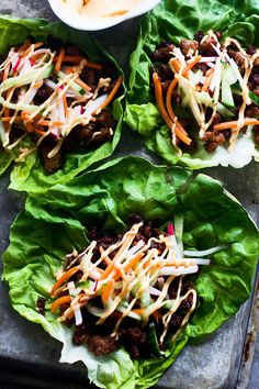 Banh Mi Lettuce Wraps - For the pork filling: 1 teaspoon sesame oil 1 teaspoon olive oil 1 pound ground pork 4 teaspoons soy sauce 2 teaspoons fish sauce 1 teaspoon sriracha 2 teaspoons brown sugar 6 pieces Boston lettuce  Includes pickled vegetables and sriracha mayo.