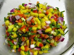 A very colorful, very tasty, and very spicy Mango Habanero Salsa recipe that is excellent as a condiment with grilled fish or as a snack with chips!