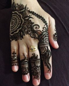 Black mehndi design for fingers and hand