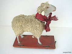 A fantastic antique sheep pull toy. It's amazing.