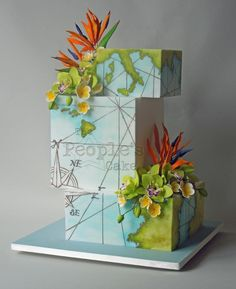 Vintage map and tropical flowers wedding cake