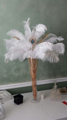 then there's always white.....if not running with the aqua-Ostrich/peacock feather centerpiece