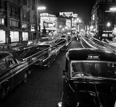 Piccadilly at night. 1950. By John Gay.