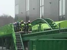Motorcycle roller coaster, this is in the Netherlands. Trust some riders to wear full leathers on the bikes!