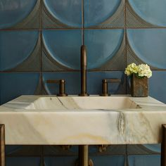 """8"""" x 8"""" MADE Modern Ribbed Moon in New Lagoon gloss (wall backsplash) with Kallista Vir Stil by Laura Kirar console table and basin set in bronze (plumbing)."""