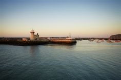 Tidily positioned at the foot of a bulbous peninsula, the pretty port village of Howth (the name rhymes with 'both') is a major fishing centre, a...