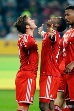 Bayern Munich players Mario Götze and David Alaba celebrate.