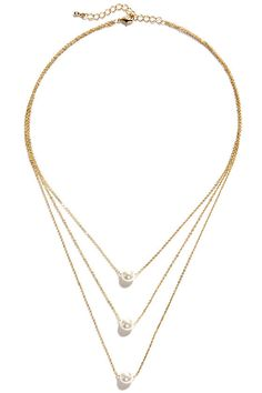 "Even if you're not always immaculate, the Pearl-fectionist Layered Pearl Necklace offers a polished look you can count on! Three layers of dainty gold chain are strung with one faux pearl apiece. Necklace drops 2.5"" at center, and measures 15"" around, plus a 2"" extender chain. Lobster clasp closure. Man made materials."