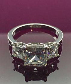 Three stone princess ring set AAAAA grade cubic zirconia .925 sterling