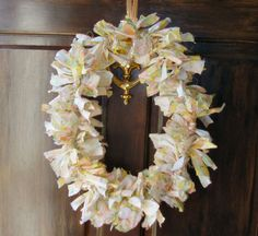 FABRIC WREATH. Supplies needed: 1 yard of cotton fabric (quilting fabric works great because it's easy to tear in straight lines), 1 clothes hanger, ribbon that matches the fabric, scissors and wire cutters are optional. This link is for an Easter wreath but it's easy to use different colors for other holidays.