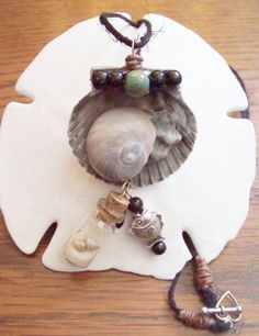 Scallops moons and kitten's paw Necklace by regiooaksartist, $15.00