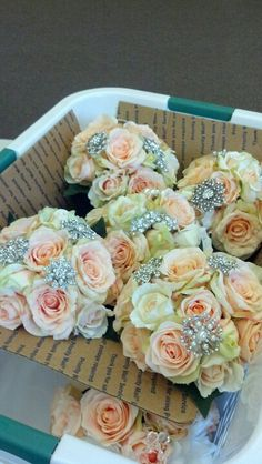 Peach brooch bouquets.