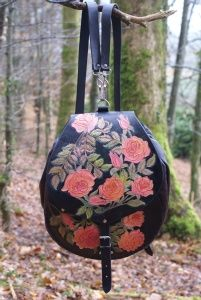 small intricately carved rose rucksack bag. http://www.skyravenwolf.com/index.php