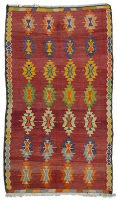 Vintage Turkish kilim rug hand-woven in Milas, an ancient town in southwestern Turkey, in mid 20th century. This tribal kilim is in good condition.