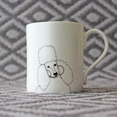 Bone china poodle mug by Nadia Sparham. Designed and made in the UK.