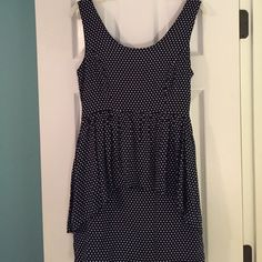 Forever 21 peplum style dress Navy blue with white polka dots. Key hole opening and tie in the back. In great condition! Dresses