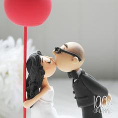 Custom Wedding Cake Topper- Romantic Kissing Couple with a Red Balloon. $110,00, via Etsy.