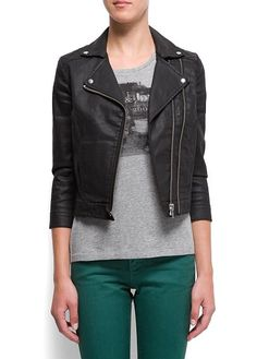 Biker jacket crafted in coated denim with zip fastening through front with a zip decorative detail, lapels with metallic rivets, quilted detail at shoulders and two front pockets by Mango EUR49.99