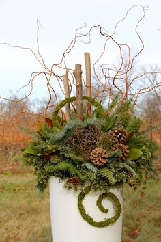 Like the artistic use of the greens here and the curly willow...for January.
