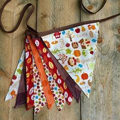 Thanksgiving Fabric Flag Banner Bunting. Use this beautiful fabric bunting for years! Ideal for decorating your classroom, home, or porch. Each flag is approximately 9 inches in height. Red, orange, brown and white prints accent a variety of decorating and Autumn themes. Perfect for decorating your home, porch or mantel! Generous ends allow the bunting to be easily tied to hang. Total finished length is approximately 9 feet and includes 9 fabric flags. This bunting is fully reversible as...