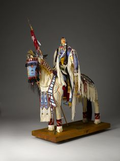 Horse and Rider by ,Juanita Growing Thunder Fogarty (Assiniboine / Sioux Dakota), 2003, Wood, hide, cloth, glass beads, paint, hair, quill, and metal.   (Photo by Kiyoshi Togashi)