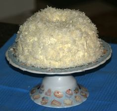 Learn how to make carrot cake recipe. This is a coconut almond carrot cake recipe. This is baked in a 9 inch bundt pan. Combine ingredients and pour into prepared pan bake for 35 minutes. When cake is cool frost with a cream cheese frosting then sprinkle coconut over top and sides.