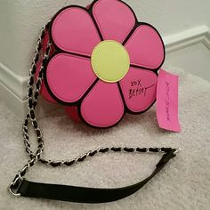"""So Pretty! Pink Betsey Johnson flower crossbody Brand new super trendy gold and leather chain strap Betsey Johnson pink crossbody. Such a great statement piece! Big enough to fit your cellphone, credit cards and lipstick and mirror! Measures 8.5"""" wide and strap is 10"""" long. No PayPal or trades. Betsey Johnson Bags Crossbody Bags"""