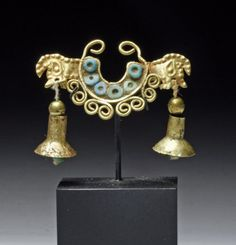 Northern Peru, Ca 100 to 300 CE.  Another superb example of early Peruvian gold work!  Delicate nose ornament in high karat gold