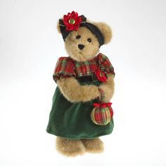 All dressed up and ready for the holiday cotillion, Elizabeth Tartenbeary, from the holiday Tartenbeary Collection, wears a dress featuring a tartan plaid  (a first for Boyds!) with green and black velour fabrics.  Elizabeth holds an ornament shaped, tar