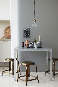 precious metals. pendant lamps (plus i love those stools!) from house doctor.