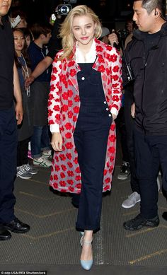 Chic: Chloe Grace Moretz rocked a pair of navy dungarees with a floral jacket as she atten...