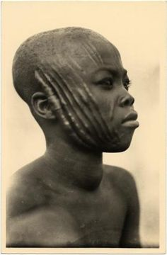 Africa | Yound man from French Equatorial Africa (now Gabon, the Republic of the Congo, the Central African Republic and Chad). | From the Casimir Zagourski African postcards, 1924-1941