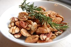 The preparation method for these pecans includes soaking them in a brine flavored with maple syrup, bourbon, and fresh rosemary. The resulting nuts are incredibly crunchy and infused with a woodsy, herbaceous flavor. Adapted from Tuesday Recipe...