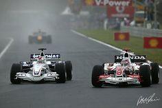 Hungaroring 2006, Robert Kubica (BMW Sauber F1.06)  taking the inside line at Takuma Sato (Super Aguri SA06)