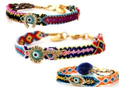 Friendship bracelets in vibrant colors-- the evil eyes are a fab touch! I make my own and mix with store bought ones.