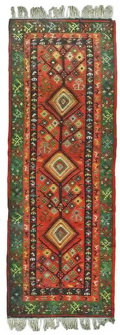 """Литије и кубета на диреци"", Пиротски ћилим. Pirot kilim is a unique and highly regarded brand of flat tapestry-woven carpets or rugs, made of pure sheep's wool ( from Stara Planina, southeastern Serbia), dyed with natural colours and long enduring. Has 28 weave lines in 1cm and both sides of the rug can be used. Its patterns and ornaments are unique: 96 of them are geographically protected and exclusive for Pirot, Serbia."