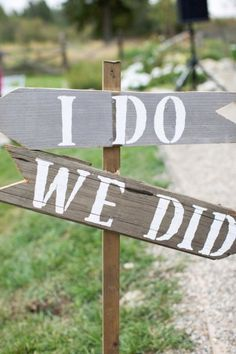 """Simple and witty, the """"I do"""" and """"we did"""" signs are a creative alternative to the typical ceremony and reception arrows. Photo by Brooke Boling via Style Me Pretty"""