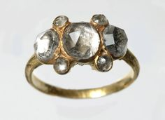 Cheapside Hoard: Gold finger-ring with traces of black enamel: 17th century