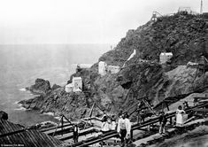 Gateway to the mines below the sea: The Crown Mines in operation in the 1860s. From this site a shaft was dug reaching 240 fathoms or 480 yards below the sea and workers could hear the waves crash above their head as they toiled