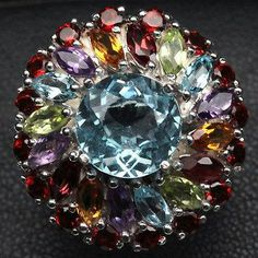 Silver ring with blue topaz, amethyst, garnet, citrine, peridot Sold by Jewellry 154,00 $